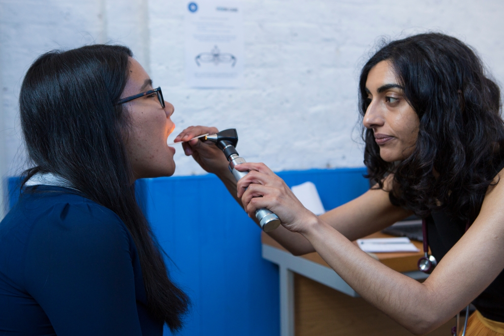 A patient is seen at Doctors of the World's drop in clinic in Bethnal Green, London.